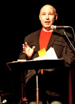 man speaking at podium tom oconnor